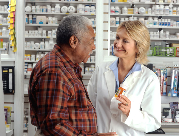 man-at-pharmacy-discussing-medicare-part-d